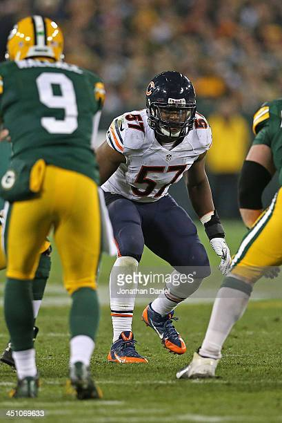 Jonathan Bostic of the Chicago Bears awaits the snap against the Green Bay Packers at Lambeau Field on November 4 2013 in Green Bay Wisconsin The...