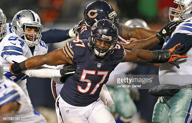 Jonathan Bostic of the Chicago Bears moves through blockers including James Hanna of the Dallas Cowboys at Soldier Field on December 9 2013 in...