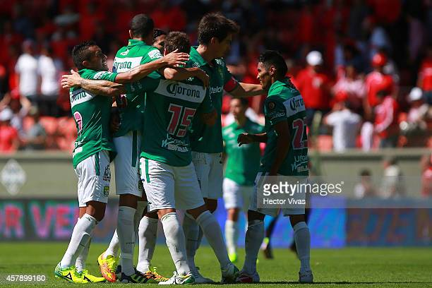 Jonathan Botinelli and his teammates celebrate after winning the match between Toluca and Leon as part of 14th round Apertura 2014 Liga MX at Nemesio...