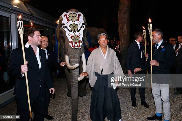 Jonathan Bouchet Manheim Kenzo Takada and Thierry Gaumard pose with an Elephant during the Kenzo Takada's 50 Years of Life in Paris Celebration at...