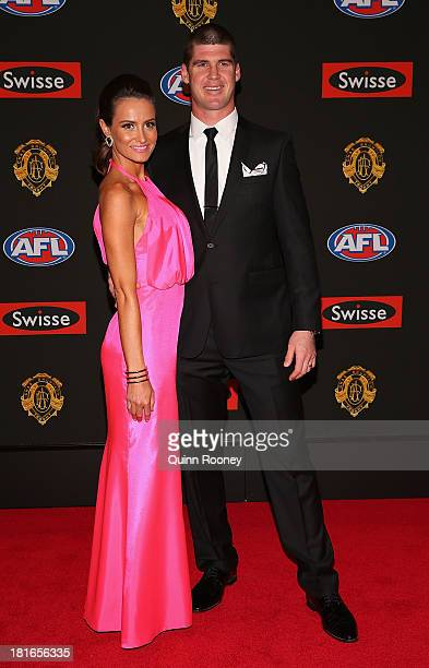 Jonathan Brown and his wife Kylie Brown arrive ahead of the 2013 Brownlow Medal at Crown Palladium on September 23 2013 in Melbourne Australia