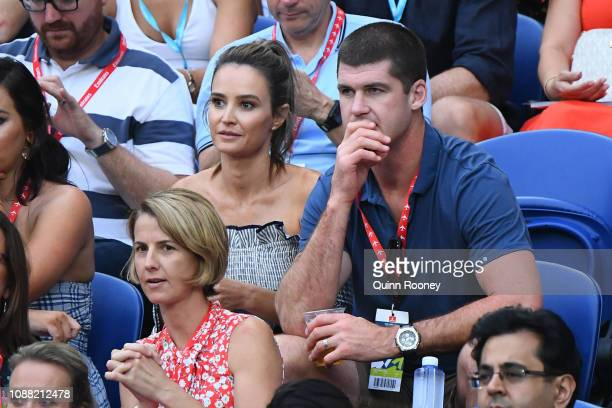Jonathan Brown and Kylie Adams watch the men's semi final match between Novak Djokovic of Serbia and Lucas Pouille of France during day 12 of the...