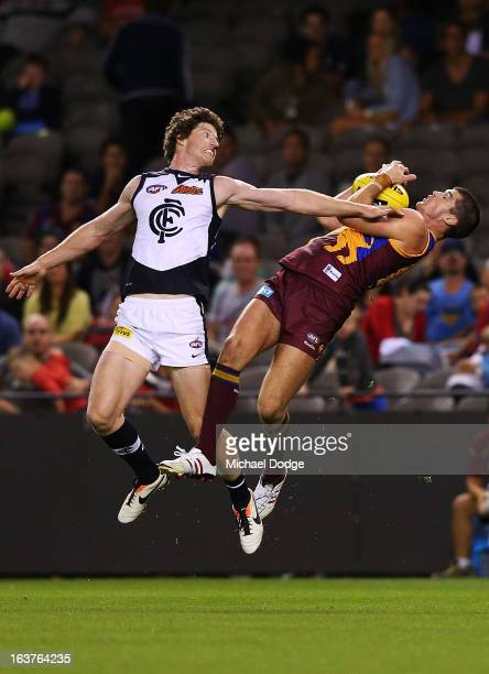Jonathan Brown of the Brisbane Lions marks the ball against Sam Rowe of the Carlton Blues during the NAB Cup AFL Grand Final match between the...
