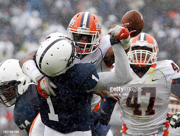 Jonathan Brown of the Illinois Fighting Illini hits Rob Bolden of the Penn State Nittany Lions causing a fumble during the game on October 29 2011 at...