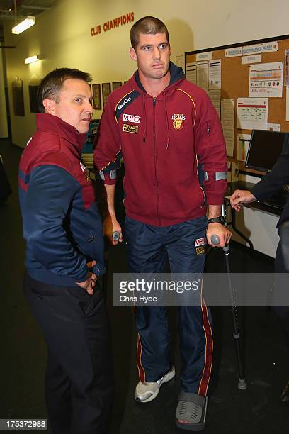 Jonathan Brown of the Lions on crutches after being injured during the round 19 AFL match between the Brisbane Lions and the St Kilda Saints at The...