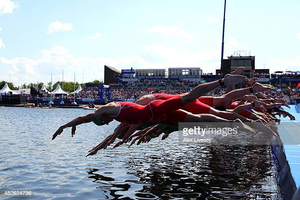 Jonathan Brownlee of England and the rest of the field dive in to the water to start the Men's Triathlon at Strathclyde Country Park during day one...