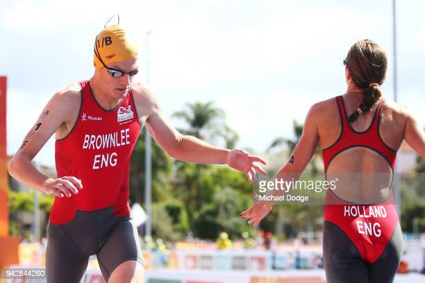 Jonathan Brownlee of England is tagged by Vicky Holland in the Mixed Team relay during the Triathlon on day three of the Gold Coast 2018 Commonwealth...