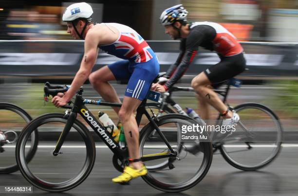 Jonathan Brownlee of Great Britain and Sven Riederer of Switzerland compete in the cycle leg during the 2012 ITU World triathlon Grand Final on...