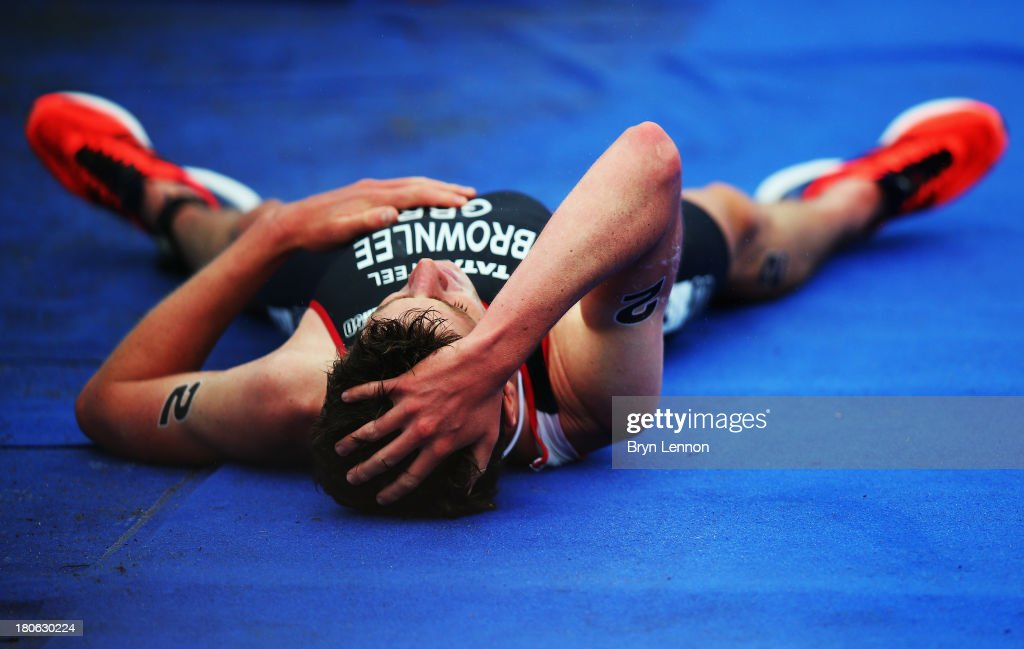 Jonathan Brownlee of Great Britain lies on the ground after finishing second in Elite Men's PruHealth World Triathlon Grand Final London and the ITU World Championships Series at Hyde Park on September 15, 2013 in London, England.
