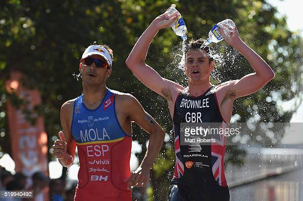 Jonathan Brownlee of Great Britain pours two bottles of water on his head during the run stage of the ITU World Triathlon Series on April 9 2016 in...