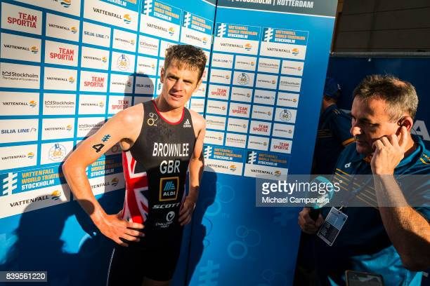Jonathan Brownlee waits to give an interview after winning the men's elite race of the Vattenfall World Triathlon Stockholm on August 26 2017 in...