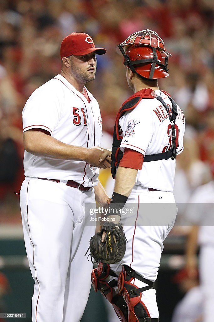 Jonathan Broxton #51 and Devin Mesoraco #39 of the Cincinnati Reds celebrate after the final out of the game against the Cleveland Indians at Great American Ball Park on August 7, 2014 in Cincinnati, Ohio. The Reds won 4-0.