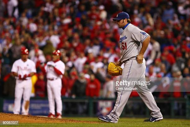 Jonathan Broxton of the Los Angeles Dodgers walks back to the mound after he hit Carlos Ruiz of the Philadelphia Phillies with a pitch in the bottom...