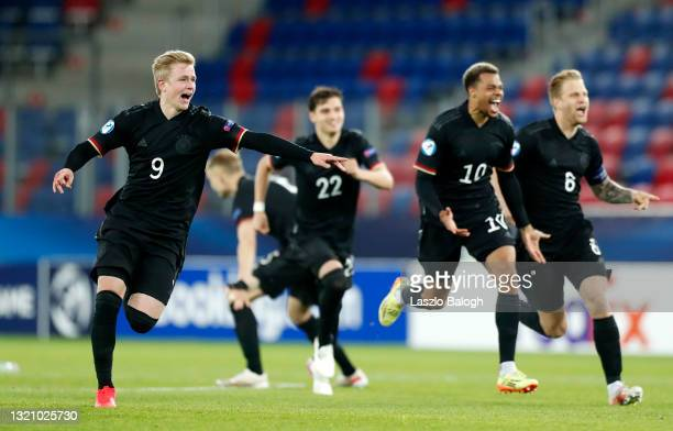 Jonathan Burkardt of Germany celebrates their side's victory following a penalty shoot out after the 2021 UEFA European Under-21 Championship...