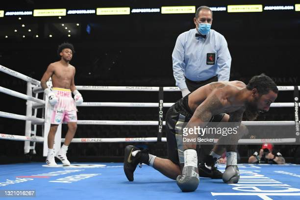 Jonathan Burrs gets up off the mat after Amari Jones knocked him down during their super welterweight bout at Michelob ULTRA Arena on May 29, 2021 in...