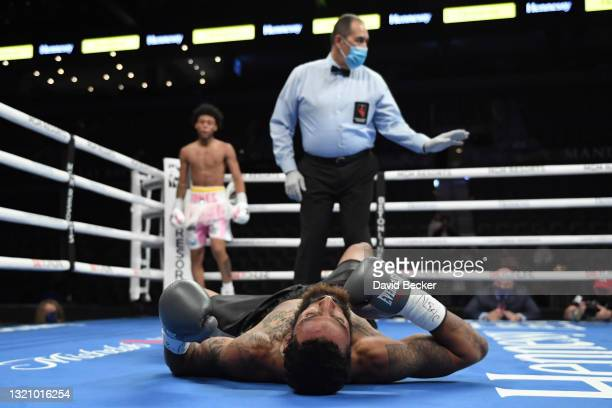 Jonathan Burrs lays on the mat after Amari Jones knocked him down during their super welterweight bout at Michelob ULTRA Arena on May 29, 2021 in Las...