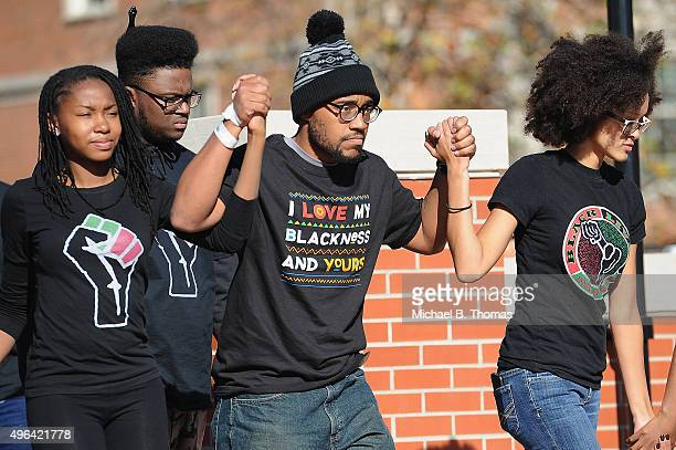 Jonathan Butler a University of Missouri grad student who did a 7 day hunger strike is greeted by the crowd of students on the campus of University...