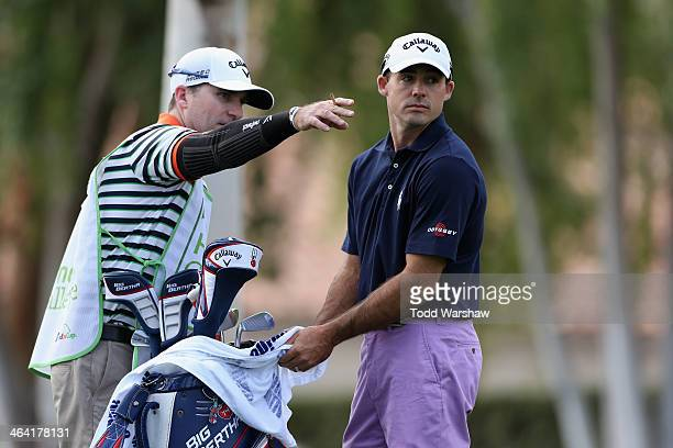 Jonathan Byrd discusses a tee shot on the second hole with his caddy during the final round of the Humana Challenge in partnership with the Clinton...