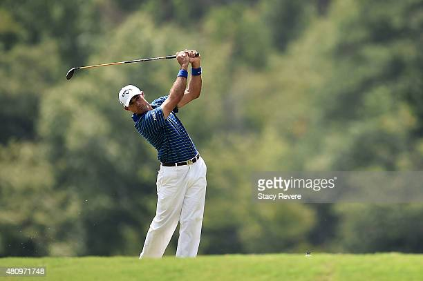 Jonathan Byrd of the United States hits his tee shot on the ninth hole during the first round of the Barbasol Championship at the Robert Trent Jones...