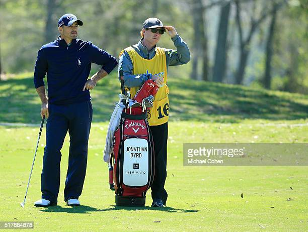 Jonathan Byrd stands by his golf bag as he prepares to play a shot during the final round of the Chitimacha Louisiana Open presented by NACHER held...