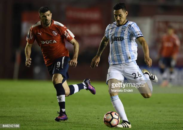 Jonathan Cabral of Atletico Tucuman drives the ball during a second leg match between Independiente and Atletico Tucuman as part of round of 16 of...