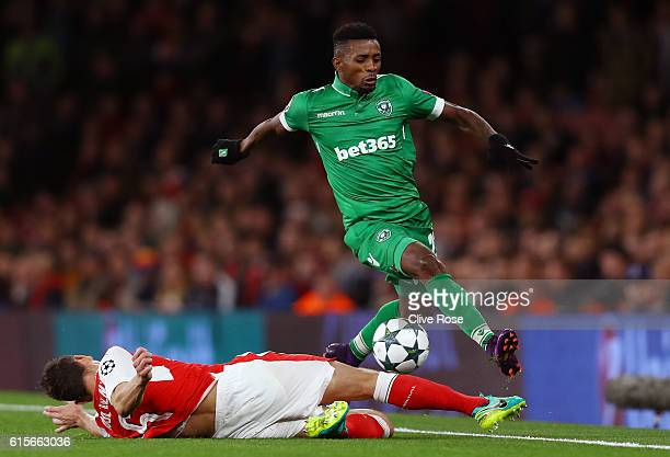 Jonathan Cafu of Ludogorets Razgrad skips over the challenge of Laurent Koscielny of Arsenal during the UEFA Champions League group A match between...
