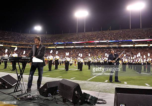 Jonathan Cain and Neal Schon of Journey perform the National Anthem before the college football game between the Arizona State Sun Devils and the USC...