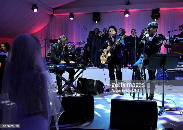 Jonathan Cain Neal Schon and Arnel Pineda perform for Michaele Schon during the wedding of Michaele Schon and Neal Schon at the Palace of Fine Arts...