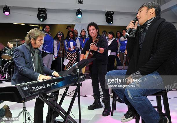 Jonathan Cain Neal Schon and Arnel Pineda rehearse for the wedding of Michaele Schon and Neal Schon at the Palace of Fine Arts on December 14 2013 in...
