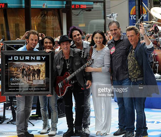 Jonathan Cain Neal Schon Arnel Pineda Deen Castronovo Ross Valory of Journey with NBC Today host Ann Curry on NBC's Today in Rockefeller Center on...