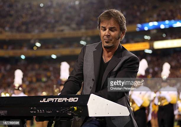Jonathan Cain of Journey perform the National Anthem before the college football game between the Arizona State Sun Devils and the USC Trojans at Sun...