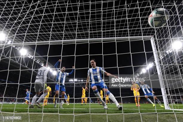 Jonathan Calleri and Bernardo Espinosa of Espanyol celebrate in the foreground as David Lopez of Espanyol celebrates after scoring his team's first...