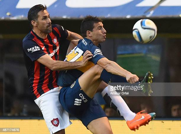 Jonathan Calleri of Boca Juniors and Mario Yepes of San Lorenzo fight for the ball during a match between Boca Juniors and San Lorenzo as part of...