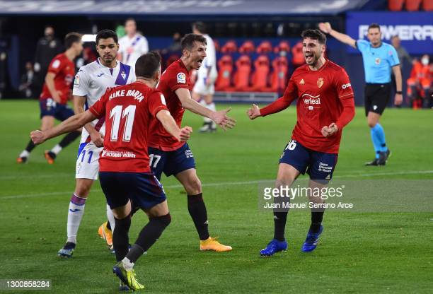 Jonathan Calleri of C.A. Osasuna celebrates with teammates Ante Budimir and Kike Barja of C.A. Osasuna after scoring their team's first goal during...