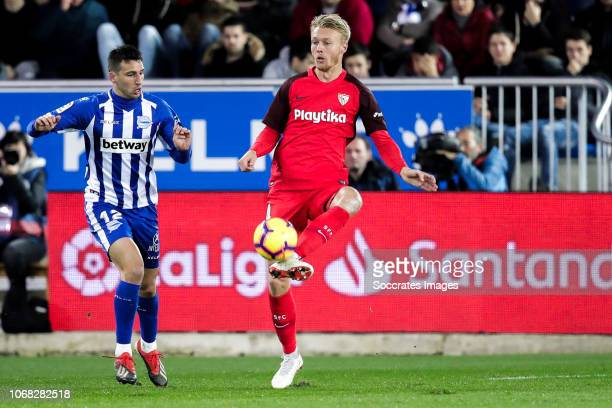 Jonathan Calleri of Deportivo Alaves Simon Kjaer of Sevilla FC during the La Liga Santander match between Deportivo Alaves v Sevilla at the Estadio...