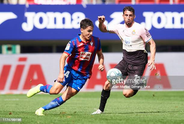 Jonathan Calleri of RCD Espanyol duels for the ball with Alvaro Tejero of SD Eibar during the Liga match between SD Eibar SAD and RCD Espanyol at...