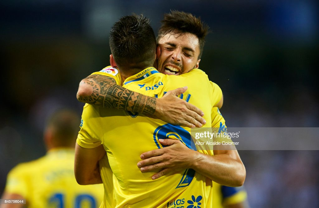 Jonathan Calleri of Union Deportiva Las Palmas (R) celebrates after scoring with Ximo Navarro of Union Deportiva Las Palmas (L) during the La Liga match between Malaga and Las Palmas at Estadio La Rosaleda on September 11, 2017 in Malaga, .