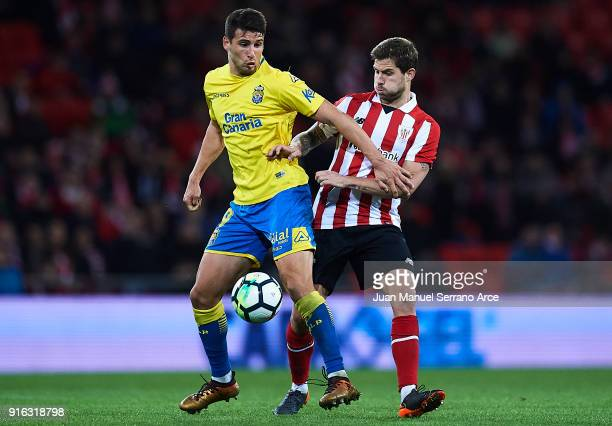 Jonathan Calleri of Union Deportiva Las Palmas competes for the ball with Inigo Martinez of Athletic Club during the La Liga match between Athletic...