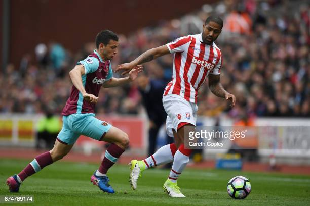 Jonathan Calleri of West Ham United closes down Glen Johnson of Stoke City during the Premier League match between Stoke City and West Ham United at...