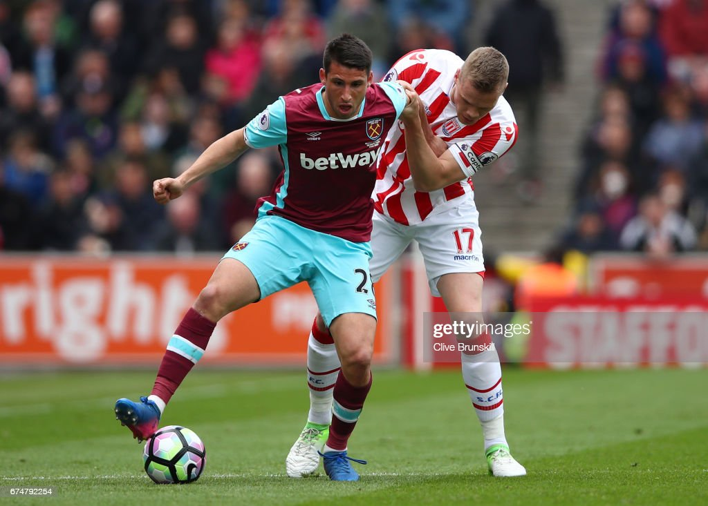 Jonathan Calleri of West Ham United is closed down by Ryan Shawcross of Stoke City during the Premier League match between Stoke City and West Ham United at Bet365 Stadium on April 29, 2017 in Stoke on Trent, England.