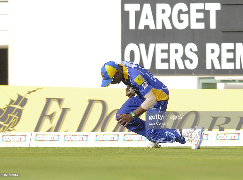 Jonathan Carter of Barbados Tridents catches a ball thrown by David Hussey (not in frame) of Antigua Hawksbills during a match between Barbados Tridents and Antigua Hawksbills as part of the week 3 of Caribbean Premier League 2014 at Kensington Oval on July 25, 2014 in Bridgetown, Barbados.