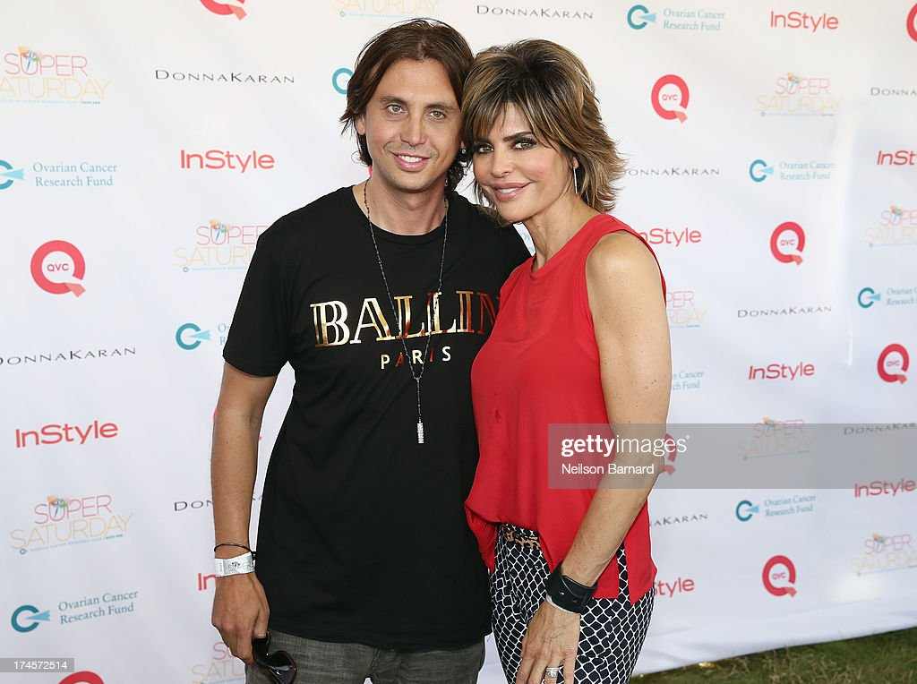 Jonathan Cheban (L) and QVC Red Carpet Host Lisa Rinna attend QVC Presents Super Saturday LIVE! at Nova's Ark Project on July 27, 2013 in Water Mill, New York.