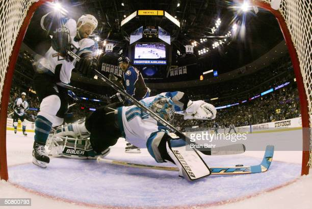 Goalie Evgeni Nabokov of the San Jose Sharks makes a save against the Colorado Avalanche in the second period of game six of the Western Conference...