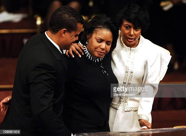 Jonathan Cochran hugs his sisters Tiffany Cochran Edwards and Melodie Cochran during the funeral service for their father Johnnie Cochran at the West...