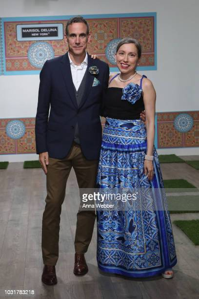 Jonathan Cole and Marisol Deluna pose after the Marisol Deluna New York Fashion Week presentation at Tals Studio on September 11 2018 in New York City