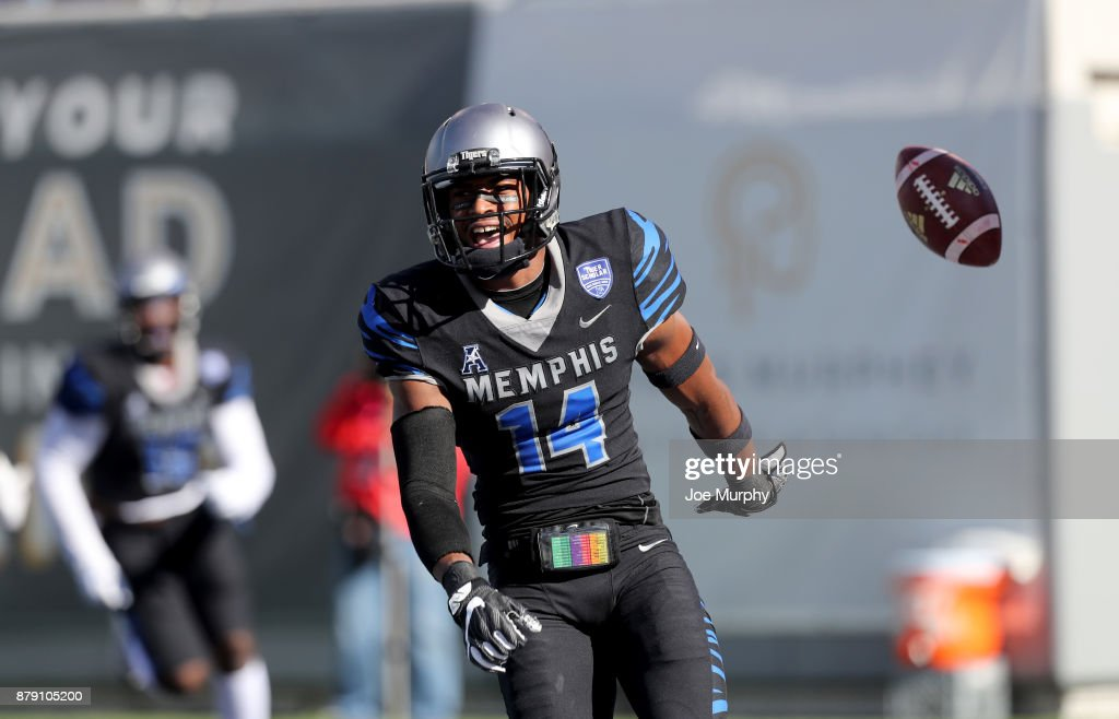 Jonathan Cook #14 of the Memphis Tigers celebrates a touchdown after an interception against the East Carolina Pirates on November 25, 2017 at Liberty Bowl Memorial Stadium in Memphis, Tennessee.