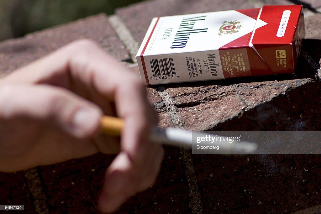 Jonathan Cook smokes a Marlboro 100's cigaratte -on the