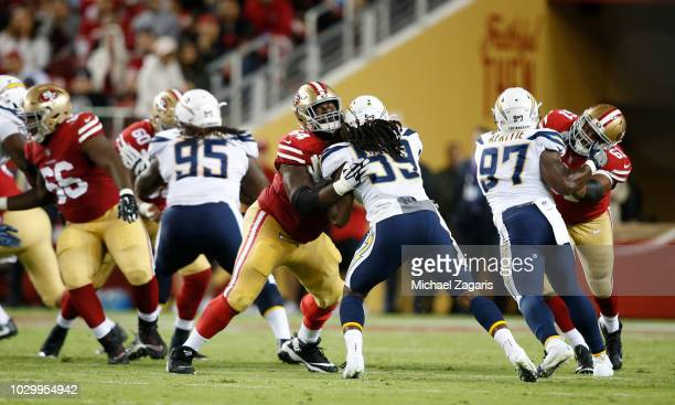 Jonathan Cooper and Andrew Lauderdale of the San Francisco 49ers block during the game against the Los Angeles Chargers at Levi Stadium on August 30...