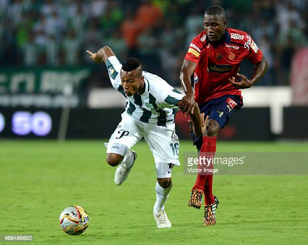 Jonathan Copete of Atletico Nacional fights for the ball with Andres Mosquera of Deportivo Independiente Medellin during a match between Atletico...