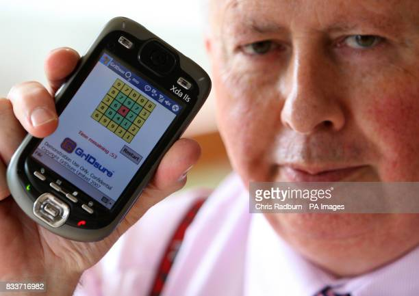 Jonathan Craymer of Warboys Cambridgeshire holds his invention the GrIDsure security system which was one of a number of inventions unveiled at an...